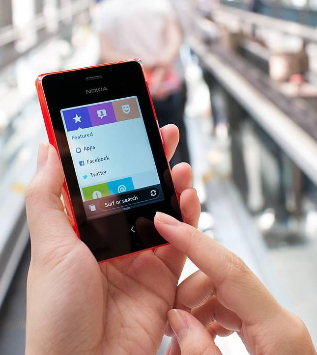 Мобильный телефон Nokia Asha 500 Dual Sim красный - фото 5